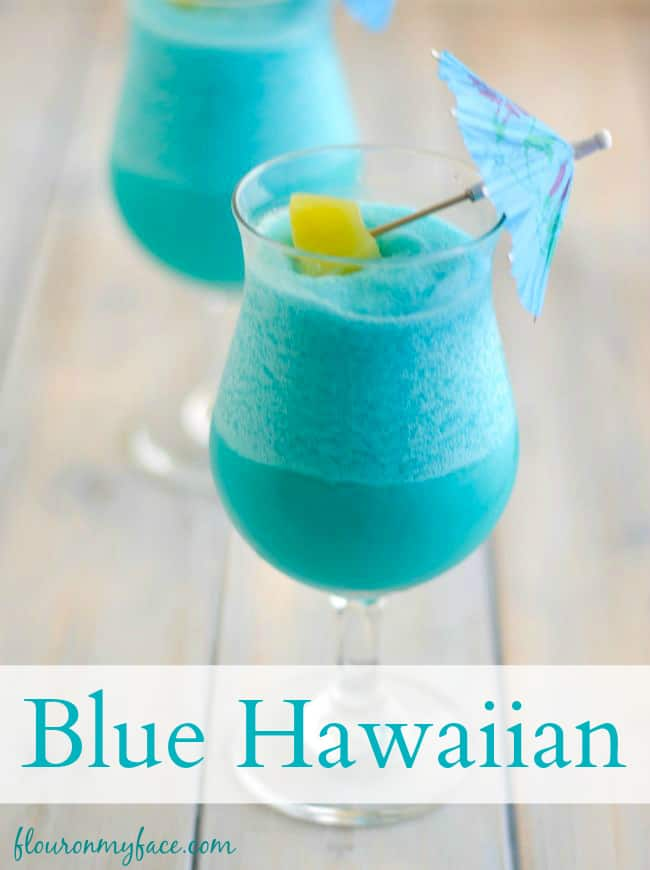 Frozen Blue Hawaiian Cocktail by Flour On My Face - Nothing screams summer more than frosty fruity drinks. Wine slushies, mules, sangria,  mimosas, cocktails, margaritas, and more! Graduations, Memorial Day, Fourth of July, or just a summer gathering with friends and family are all great reasons to throw a summer party.  No summer party is complete without fruity, slushy, cold drinks. You'll love these 10 summer drink recipes.  You'll be happy you tried them all. #summerdrinks #summerdrinkrecipes #foodanddrink #frozendrinks #wineslushies #frozencocktails #cocktails #partydrinks #partydrinkrecipes #HWS #healthywealthyskinny