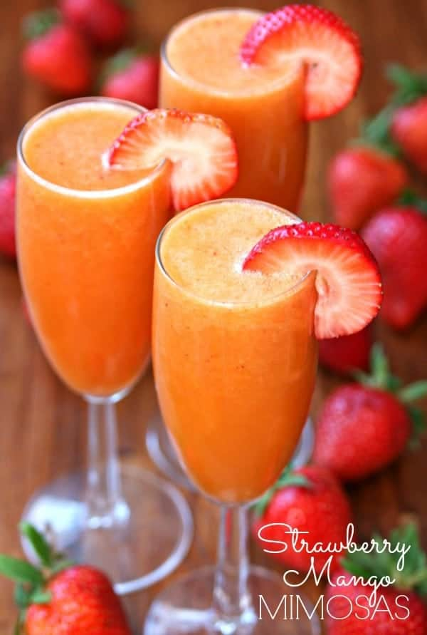 Strawberry Mango Mimosas by Happy Go Lucky - Nothing screams summer more than frosty fruity drinks. Wine slushies, mules, sangria,  mimosas, cocktails, margaritas, and more! Graduations, Memorial Day, Fourth of July, or just a summer gathering with friends and family are all great reasons to throw a summer party.  No summer party is complete without fruity, slushy, cold drinks. You'll love these 10 summer drink recipes.  You'll be happy you tried them all. #summerdrinks #summerdrinkrecipes #foodanddrink #frozendrinks #wineslushies #frozencocktails #cocktails #partydrinks #partydrinkrecipes #HWS #healthywealthyskinny