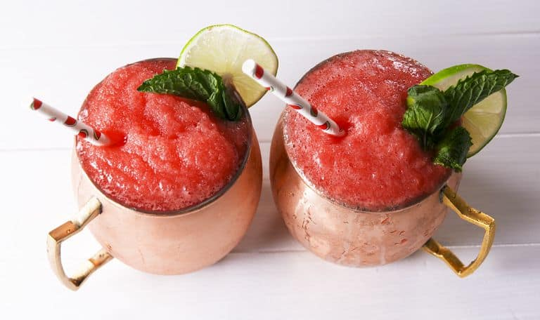 Frozen Watermelon Mules by Delish - Nothing screams summer more than frosty fruity drinks. Wine slushies, mules, sangria,  mimosas, cocktails, margaritas, and more! Graduations, Memorial Day, Fourth of July, or just a summer gathering with friends and family are all great reasons to throw a summer party.  No summer party is complete without fruity, slushy, cold drinks. You'll love these 10 summer drink recipes.  You'll be happy you tried them all. #summerdrinks #summerdrinkrecipes #foodanddrink #frozendrinks #wineslushies #frozencocktails #cocktails #partydrinks #partydrinkrecipes #HWS #healthywealthyskinny