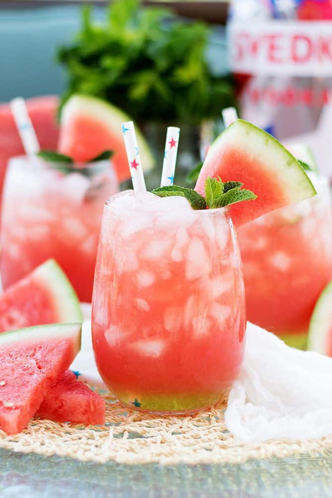Vodka Watermelon Coolers by Jennifer Meyerling - Nothing screams summer more than frosty fruity drinks. Wine slushies, mules, sangria,  mimosas, cocktails, margaritas, and more! Graduations, Memorial Day, Fourth of July, or just a summer gathering with friends and family are all great reasons to throw a summer party.  No summer party is complete without fruity, slushy, cold drinks. You'll love these 10 summer drink recipes.  You'll be happy you tried them all. #summerdrinks #summerdrinkrecipes #foodanddrink #frozendrinks #wineslushies #frozencocktails #cocktails #partydrinks #partydrinkrecipes #HWS #healthywealthyskinny