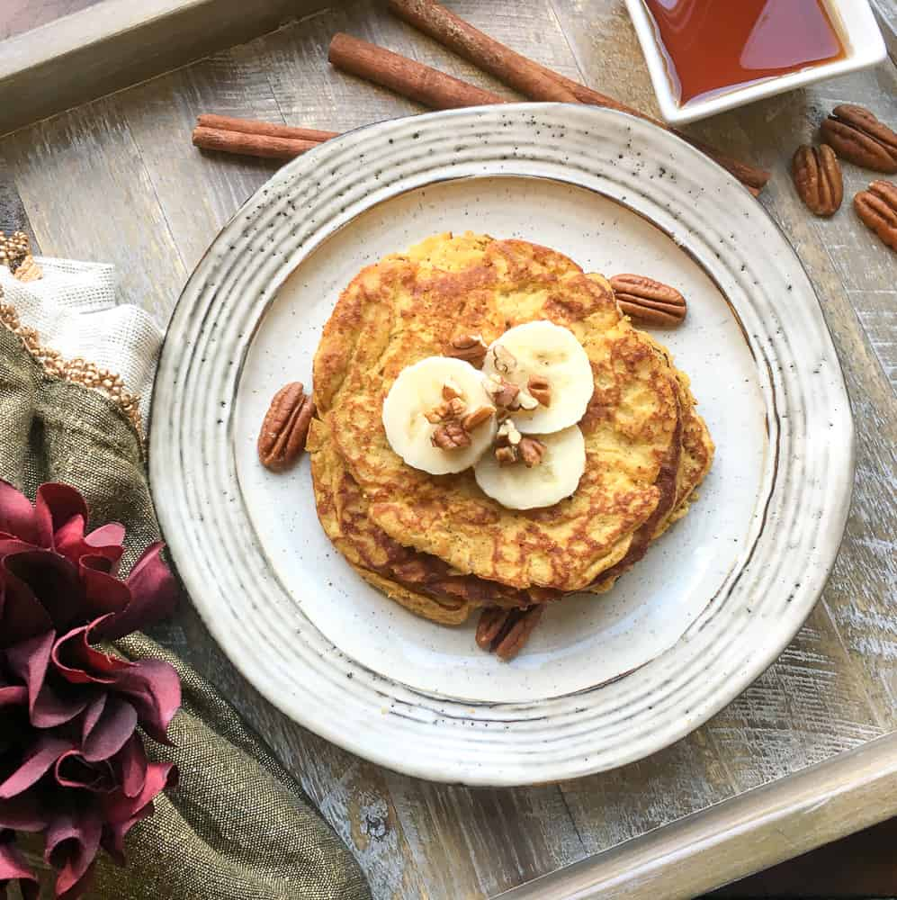 Paleo Pumpkin Spice Pancakes | Starting your day with the perfect breakfast just makes your entire day run smoother. These grain-free, pumpkin-packed, and super delicious Paleo Pumpkin Spice Pancakes definitely do the trick. #paleo #pumpkin #pumpkinspice #pumpkinpancakes #pancakes #HWS #healthywealthyskinny