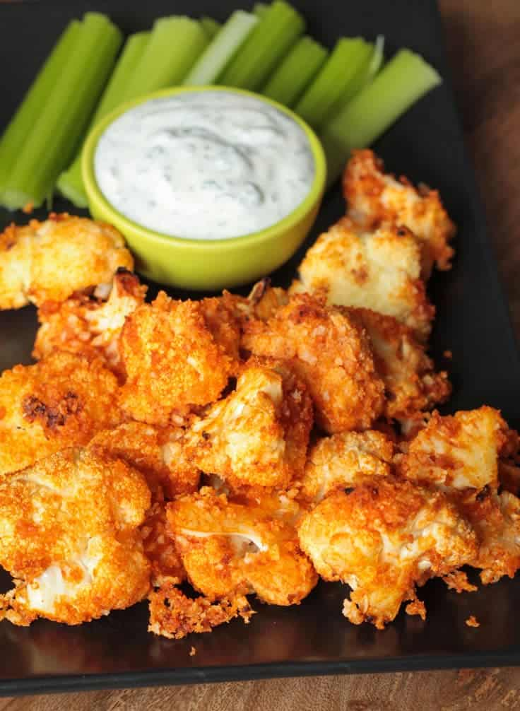 Buffalo Cauliflower Bites by Veggie Inspired | Super Bowl Party Food Ideas for your next super bowl party.  Get Super Bowl recipes for appetizers, main dishes,  chicken wings, drinks and cocktails. Find party food recipes to make your football party a crowd favorite. #superbowl #partyfood #partyrecipes #foodanddrink #superbowlparty #HWS #healthywealthyskinny