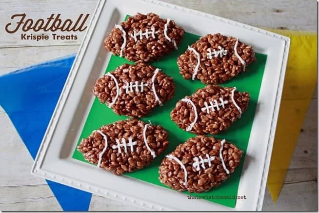 Football Rice Krispie Treats by That's What Che Said | Super Bowl Party Food Ideas for your next super bowl party.  Get Super Bowl recipes for appetizers, main dishes,  chicken wings, drinks and cocktails. Find party food recipes to make your football party a crowd favorite. #superbowl #partyfood #partyrecipes #foodanddrink #superbowlparty #HWS #healthywealthyskinny