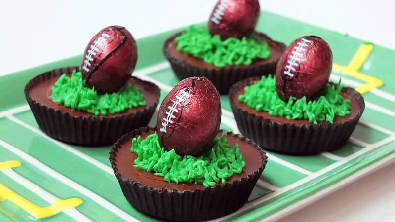 Game Day Peanut Butter Cups by Tablespoon | Super Bowl Party Food Ideas for your next super bowl party.  Get Super Bowl recipes for appetizers, main dishes,  chicken wings, drinks and cocktails. Find party food recipes to make your football party a crowd favorite. #superbowl #partyfood #partyrecipes #foodanddrink #superbowlparty #HWS #healthywealthyskinny