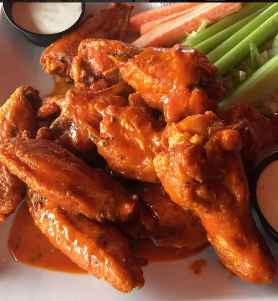 Buffalo Chicken Wings by Mama Maggie's Kitchen | Super Bowl Party Food Ideas for your next super bowl party.  Get Super Bowl recipes for appetizers, main dishes,  chicken wings, drinks and cocktails. Find party food recipes to make your football party a crowd favorite. #superbowl #partyfood #partyrecipes #foodanddrink #superbowlparty #HWS #healthywealthyskinny