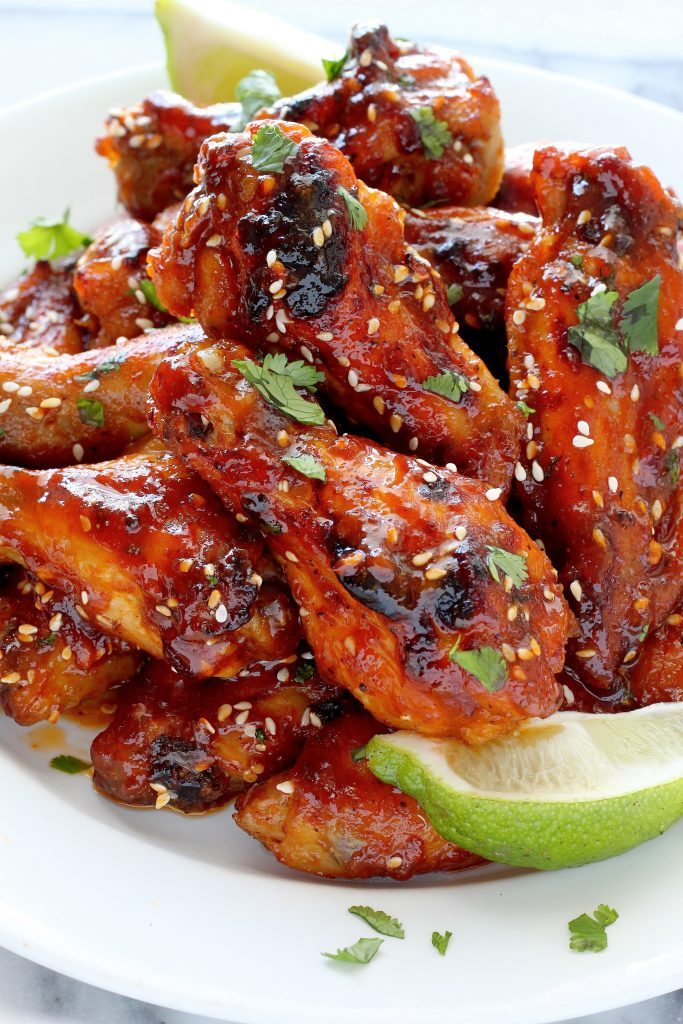 Sweet and Spicy Sriracha Baked Chicken Wings by Baker by Nature | Super Bowl Party Food Ideas for your next super bowl party.  Get Super Bowl recipes for appetizers, main dishes,  chicken wings, drinks and cocktails. Find party food recipes to make your football party a crowd favorite. #superbowl #partyfood #partyrecipes #foodanddrink #superbowlparty #HWS #healthywealthyskinny