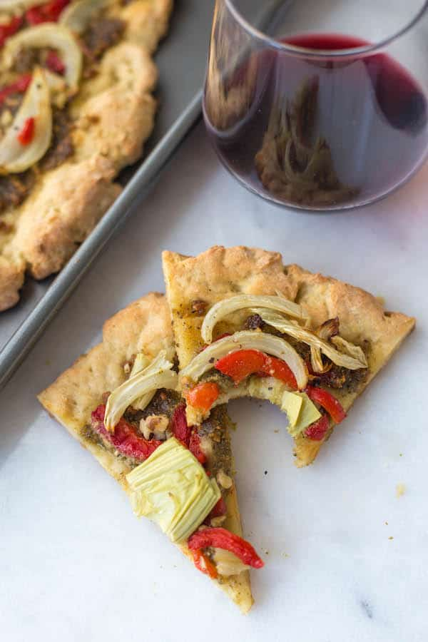 Gluten Free Fennel Pesto Pizza by Fooduzzi | Super Bowl Party Food Ideas for your next super bowl party.  Get Super Bowl recipes for appetizers, main dishes,  chicken wings, drinks and cocktails. Find party food recipes to make your football party a crowd favorite. #superbowl #partyfood #partyrecipes #foodanddrink #superbowlparty #HWS #healthywealthyskinny